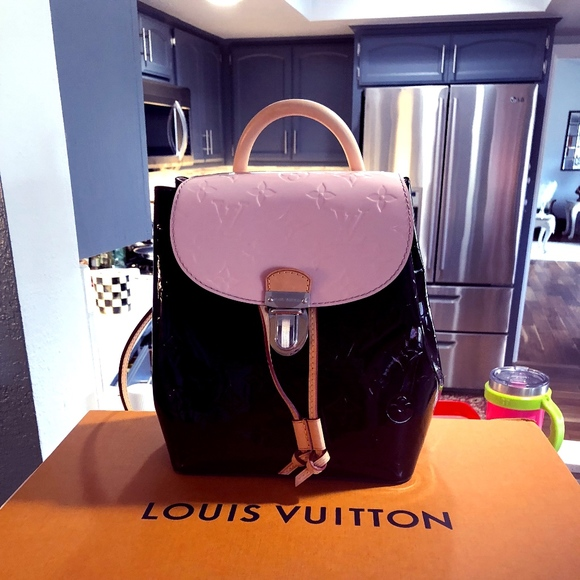 726d999895d5 Handbags - Louis Vuitton Hot Springs Backpack